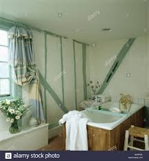 Small Cottage Bathroom Painted Pastel Green Beams On Wall Of Small White Cottage Bathroom