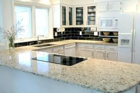 What Color Granite Goes With White Cabinets by White Cabinets Black Granite Countertops Pictures Kitchen Grey