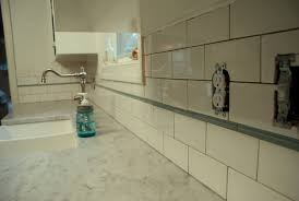 Installing Tile Backsplash How To Install Kitchen Backsplash Tile Around Outlets Home