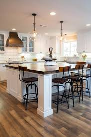 Kitchen Islands Bars Two Pendant Lights Illuminate A New Kitchen Island With A