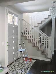 spray painting a door using graco airless spray gun or paint pics