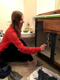 how to paint wood cabinets without sanding how to paint bathroom cabinets