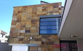 modern housing development in brno clad in natural stone cupa