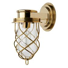 discover compass wall mounted single arm sconce with glass shade