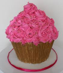 pink and gold giant smash cupcake rosette buttercream cake