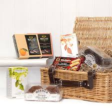 traditional tea and biscuits gift hamper in luxury wicker basket