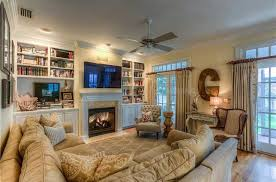 Traditional Family Room With Builtin Bookshelf  Ceiling Fan In - Traditional family room