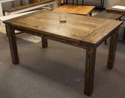 solid wood farmhouse table with breadboards distressed dark