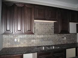 rectangle gray cream back splash with dark brown wooden cabinet