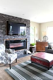 black ledgestone fireplace surround with reclaimed wood around