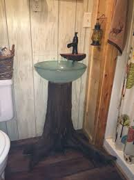bathroom sink base made from old cypress stump and faucet made