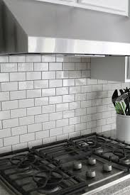best 25 white subway tile backsplash ideas on pinterest subway jennifer stagg of with heart chose dark grout when she created a subway tile backsplash in