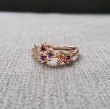 flower design rings images Blue sapphire gold flower engagement ring delicate floral jpg