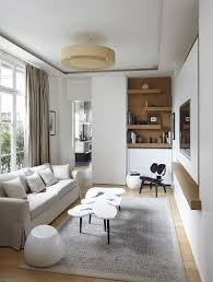 20 small tv rooms that balance style with functionality elegant tv room with modern scandinavian style design bismut bismut architectes