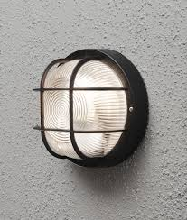 black exterior wall lights exterior caged bulkhead wall light in black or white