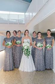 silver sequin bridesmaid dresses with bridesmaids in cap sleeved silver sequin dresses