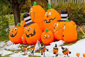 Halloween Pumpkin Inflatables In Yard With Snow Stock Photo