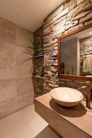 hot summer trend 25 dashing powder rooms with tropical flair bathrooms tropical style powder room with a stacked stone wall