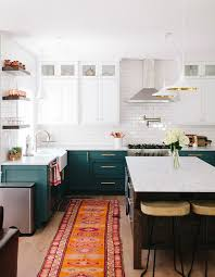 is green a kitchen color bored of white kitchens discover the cabinet color trending