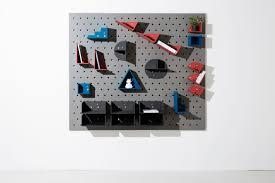 a wall mounted modular shelving system design milk