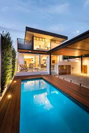 magnificent swan pool float in landscape modern with carport next