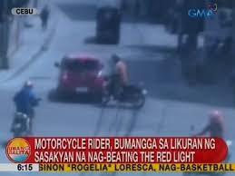beating the red light ub motorcycle rider bumangga sa likuran ng sasakyan na na beating