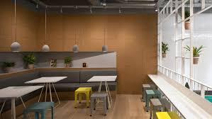 pot plants cover trellis like walls inside london cafe by