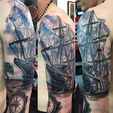 ship and compass tattoo on left half sleeve for men by luis k