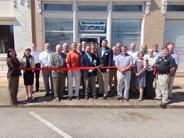 alabama ribbon ra ribbon cutting for new oxford alabama office draws local