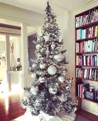 home decor wander ware i like to keep my tree decorations simple yet classic with a touch of glam clear lights silver ornaments and a white faux fur tree skirt