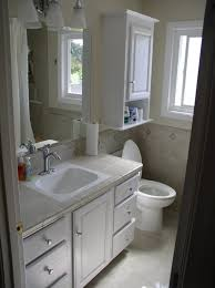 Bathroom Wall Storage Cabinets by Bathroom Bathroom With White Wooden Flatong Cabinet Over Toilet