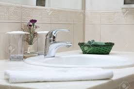 Porcelain Bathroom Accessories by Hotel Bathroom Sink Tap Towel And Bathroom Set Stock Photo