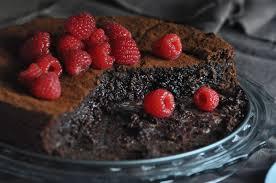 chocolate gooey almond cake sifting focus