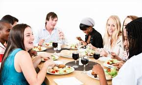 dinner host hosting a dinner party in your kitchen lifestyle magazine