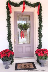 Christmas Window And Door Decorations by Choose A Christmas Door Decoration For Holiday Pizzazz