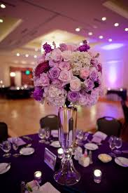 tall centerpiece with white purple and pink flowers my october