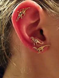 t rex earrings t rex earrings jewels earrings gold dinosaur stud earrings gold