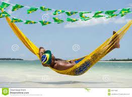 Brazillian Hammocks Brazilian Man Relaxing In Beach Hammock Over Sea Stock Photo