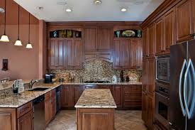 giallo fiorito granite with oak cabinets interceramic in kitchen traditional with santa cecilia light granite