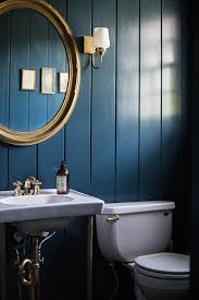 navy blue bathroom ideas why walls work in small spaces via design sponge small