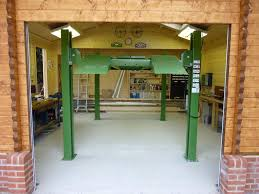 classic log cabin garage with car lift garage pinterest