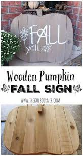 new great new wooden fall sign shaped like a pumpkin and