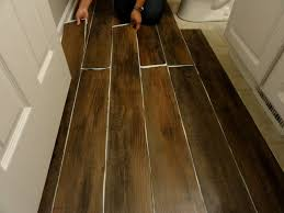Installing Vinyl Floor Tiles with Cover The Peel And Stick Floor Tile Cheaply