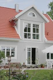 house color grey body white trim red roof lady fox