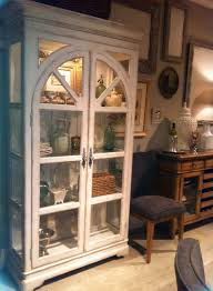 curio cabinet curioabinet with wicker rug and brick walls also