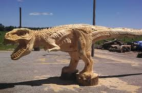 large wood carvings i need that in the foyer a chainsaw carved dinosaur geekologie