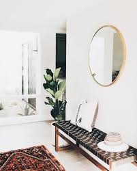 woven bench and mirror in entry way interior inspiration