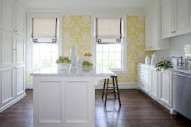 white cabinets island with marble countertop yellow pattern