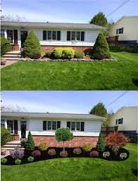 placing rocks between the wall and the flower beds keep the plants