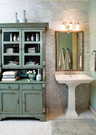 beautiful antique style pedestal sink paired with rustic storage